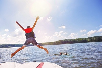 kids jumping off boat - Comparing Virginia's Lakes & Their Neighboring Properties
